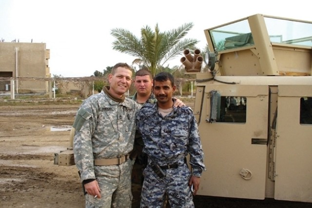 Master Sgt. John Sookikian poses with an Iraqi soldier and fellow American Soldier in the Dourya District of Baghdad in 2006. Master Sgt. Sookikian was deployed for four out of seven years while employed with Consolidated Electrical Distributors, Inc.