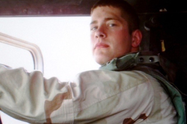 "Sgt. Keith ""Matt"" Maupin of the U.S. Army Reserve's 724th Transportation Company is shown in his vehicle sometime before April 9, 2004, when his convoy was ambushed en route to Baghdad International Airport. His remains were found in Baghdad last week and have now been positively identified."