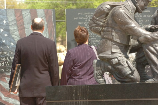 Capt. Mark Resh's parents, Charlie and Carol Resh, stand at the 1st Cavalry Division's Operation Iraqi Freedom memorial where their son's name will be forever engraved after a Silver Star presentation ceremony held the division's parade field on Fort Hood, Texas, March 26.
