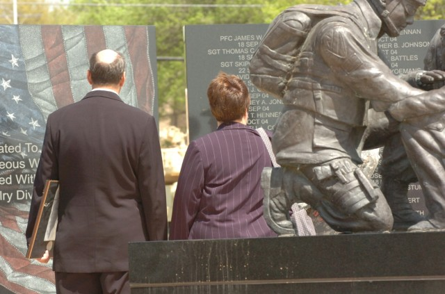 Capt. Mark Resh's parents, Charlie and Carol Resh, stand at the 1st Cavalry Division's Operation Iraqi Freedom memorial where their son's name will be forever engraved after a Silver Star presentation ceremony held the division's parade field on Fort...