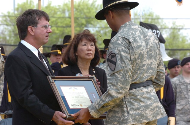 Brig. Gen. (P) Vincent Brooks, the commanding general of the 1st Cavalry Division, presents the Silver Star, the nation's third-highest award for valor, to the parents of Chief Warrant Officer 3 Cornell Chao, stepfather Glen Crowl and mother Jasmine ...