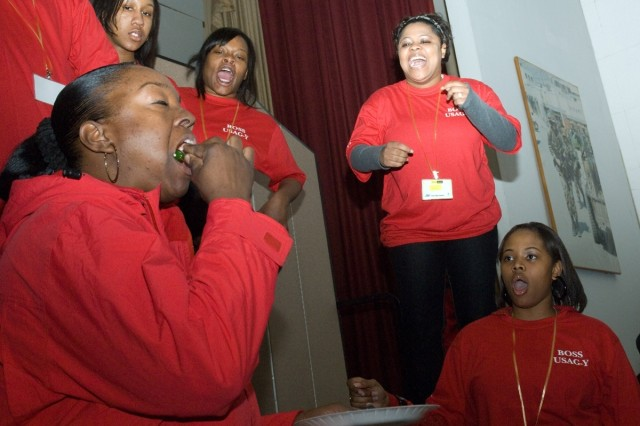 Staff Sgt. Shonda Chambers, 18th Medical Command, stuff downs a spiced pepper stuffed with garlic and onion smothered in hot sauce as her friends cheer her on.