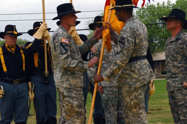 Col. Gary Volesky receives the 3rd Brigade Combat Team 1st Cavalry Division colors from Brig. Gen. Vincent Brooks, commanding general of the 1st Cavalry Division, signifying him taking charge of the unit during the brigade's change of command ceremony on the division's parade field March 27.
