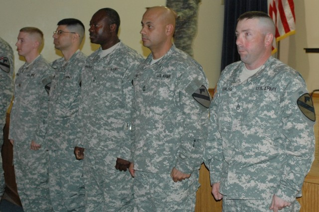 "(From left to right) Maj. Edward Kendall, 1st Cavalry Division communications section or ""G-6"" networking officer; Chief Warrant Officer 3 David Banks, G-6 network management technician; Master Sgt. Anthony Marcus, G-6 network operations noncommissioned officer-in-charge Master Sgt. Rodolfo Rico, G-6 NETOPS spectrum manager and Staff Sgt. Shannon Bowling, G-6 enhanced position location reporting system manager, wait to recieve their Bronze Order of Mercury medals from Brig. Gen. (P) Vincent K. Brooks, the commanding general of the 1st Cavalry Division at a ceremony in the Fort Hood Battle Simulation Center March 25."