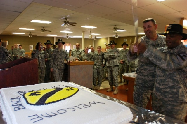 """Col. Bryan Roberts, commander 2nd Brigade Combat Team, 1st Cavalry Division, and Command Sgt. Maj. James Lee, the 2nd Brigade's top noncommissioned officer, cut the """"Cav"""" cake during the grand opening ceremony of the Black Jack Inn dining facility on Fort Hood, Texas, April 1."""