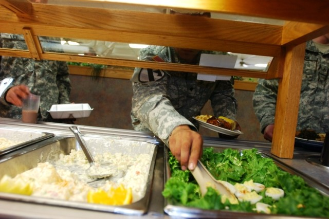 Troops from the 2nd Brigade Combat Team, 1st Cavalry Division, plucks a few deviled eggs from the salad bar during the grand opening of the Black Jack Inn dining facility on Fort Hood, Texas, April 1.