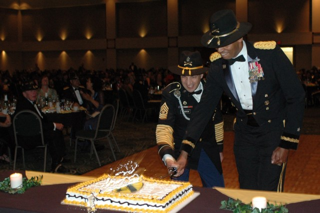 Brig. Gen. (P) Vincent K. Brooks (right), the commanding general of the 1st Cavalry Division from Alexandria, Va., cuts the cake at the division's military ball with the help of his top noncommissioned officer, Command Sgt. Maj. Philip Johndrow from Townsend, Mont., at the Killeen Civic and Conference Center March 26.