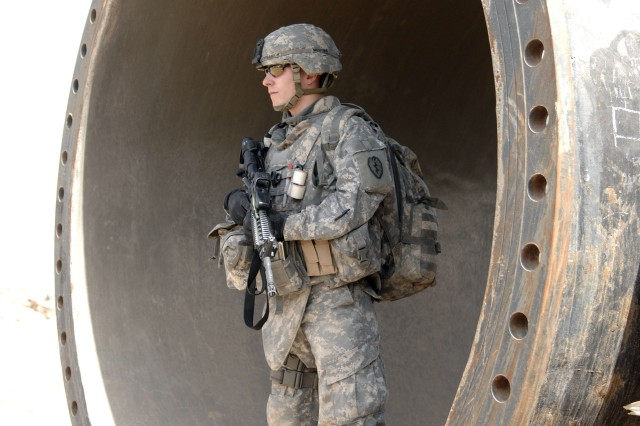 Pfc. Mike Skirkanion, from 1st Battalion, 27th Infantry Regiment, 2nd Stryker Brigade Combat Team, 25th Infantry Division, provides security at a water access point in the Taji Qada, Iraq.