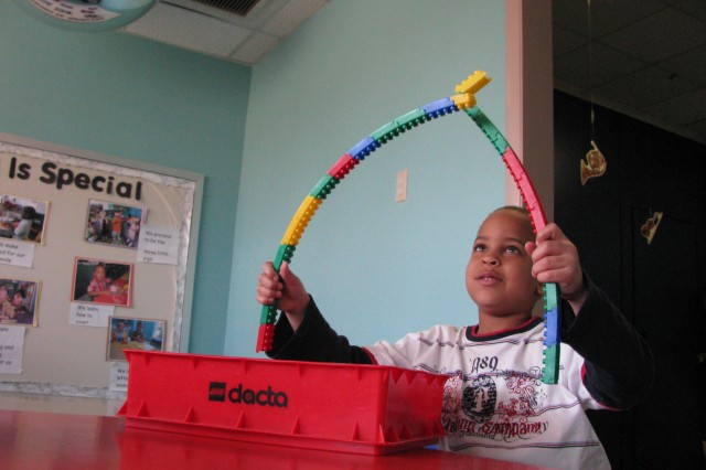 Military child Jael Kelley decides what to create March 25 at the Child Development Center.