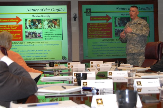 Col. Gary Cheek, deputy director of Strategy, Plans and Policy, Office of the Deputy Chief of Staff, G-3/5/7, briefs the Chicago-area World President's Organization about the Army's role in the global war on terrorism. The group, made up of prominent business people and their spouses, visited the Pentagon Thursday as part of the Army's Executive Outreach Program.
