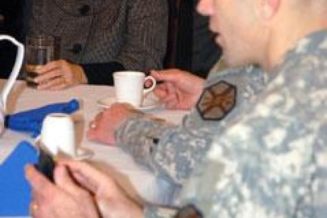 Sheila Casey talks with Fort Leavenworth, Kan., Garrison Command Sgt. Maj. John Cross II and Garrison Commander Col. Tim Weathersbee on March 27.