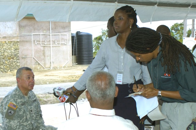 U.S. Army South Col. Robert Casias, left, the commander of the Partnership for the Americas Engagement Team - Caribbean, is interviewed by Trinidad local media representatives following the Mar. 26 opening ceremony. (Photo by Master Sgt. Brenda Benner, Texas Army National Guard)