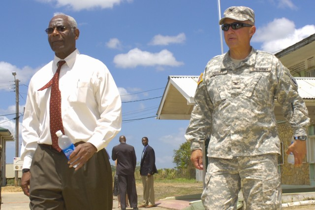 Dr. Roy L. Austin, left, the United States Ambassador to Trinidad and Tobago, and Col. Robert Casias, of United States Army South, complete the tour of Camp Mausica's headquarters Mar. 26.  (Photo by Master Sgt. Brenda Benner, Texas Army National Guard)