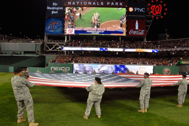 Soldiers from the Washington, D.C. National Guard unfurl an American flag on the outfield during pre-game ceremonies for the inaugural baseball game at the new Nationals Park in Washington, D.C., March 30, 2008.