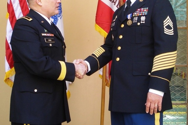 Brig. Gen. David Hogg congratulates Master Sgt. Curtis (Bobby) Elliott after pinning the Soldiers Medal on the noncommissioned officer and former platoon sergeant at the University of Southern California April 2. Elliot received the award for rescuing Soldiers from a sinking Humvee in Iraq more than four years ago.
