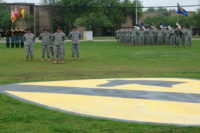 "Col. Dan Shanahan, front left, stands in front of his staff during a change of command ceremony for the 1st Air Cavalry ""Warrior"" Brigade, 1st Cavalry Division, April 4 on Cooper Field. In the ceremony, Shanahan relinquished command of the brigade to Col. Douglas M. Gabram."