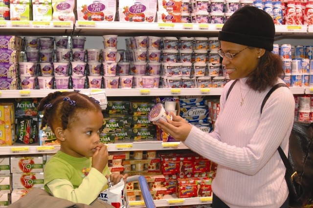 Commissary customer Ivett Boards and daughter Valerie browse some of the thousands of new items at Fort Detrick's new commissary. The facility opened April 8, 2008. The new commissary is larger and offers a greater selection for patrons. The commissary serves the active, reserve and retired military community in the Frederick area.