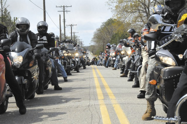 Bikers participating in Operation Rolling Thunder line up to enter a parking lot near the Insallation Safey Office April 4.  About 375 bikers - riders from all branches of the military, Civilians and Family members - embarked upon a 100-mile trek from Fort Monroe to Fort Lee to raise safety awareness.