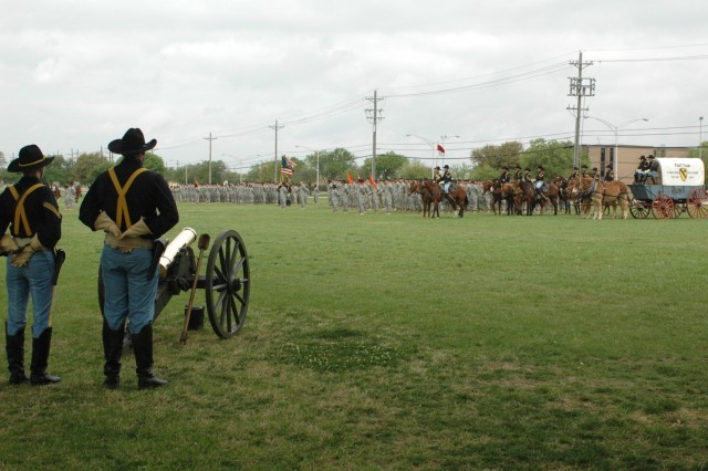 Soldiers of the 1st Cavalry Division's Division Special Troops Battalion and the Horse Cavalry Detachment stand on Fort Hood, Texas' Cooper Field during the battalion's change of command April 3.