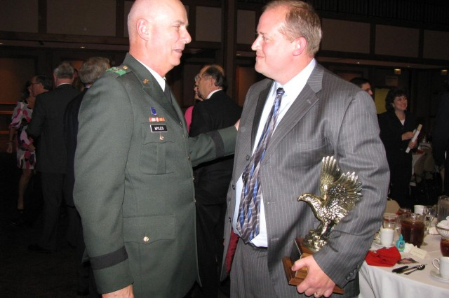 Redstone commander Maj. Gen. Jim Myles congratulates Timothy Owings for winning the 2008 Department of the Army Civilian of the Year Award presented by the Redstone-Huntsville Chapter of the Association of the U.S. Army. Ten nominees competed for the award, which was presented at an awards dinner April 2 at the Von Braun Center. Owings will go on to represent the local AUSA chapter at the regional competition.