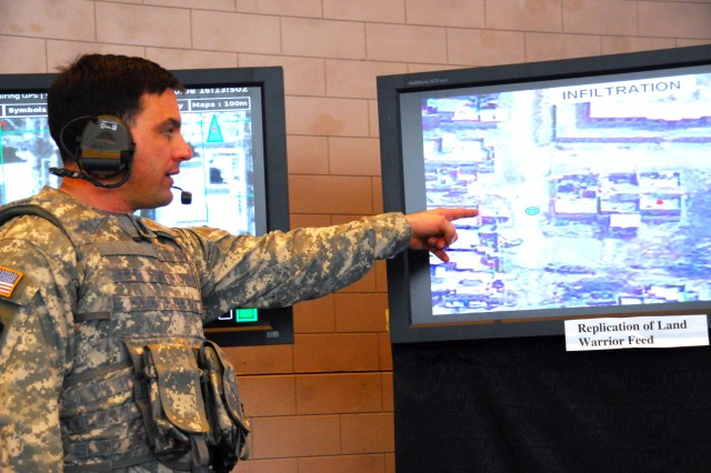 Command Sgt. Maj. Phil Pich indicates map icons representing equipment and target positions in the field. The map and icons appear in the Soldier's helmet mounted display as part of the Land Warrior system and provide situational awareness.