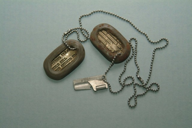 Identification Tags and P-38 Can Opener. Sergeant Russell Hill used this P-38 can opener during his service with the 787th Anti-Aircraft Automatic Weapons Battalion (Semimobile) in Europe in 1944-1945 (Army Heritage Museum).