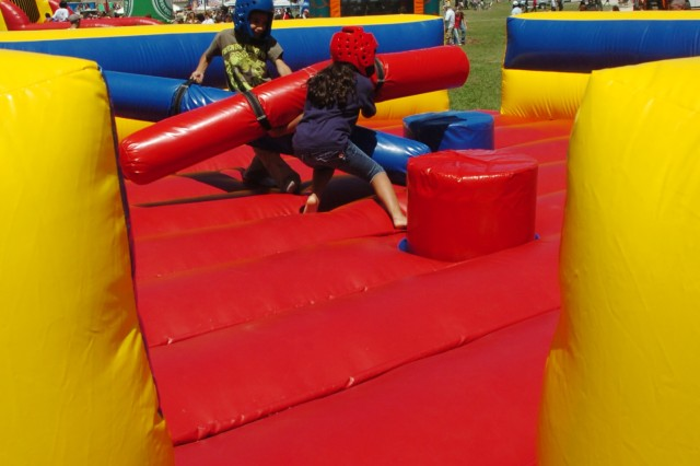 The daughter and son of Jose Morales Veronica and Antonio Morales, a set of 8-year-old twins, battle it out in the pugle ring during the 'Salute to our Heroes' event held at Fort Hood, Texas, April 11. According to their father the match was a