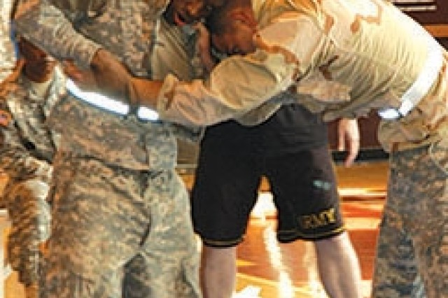 Staff Sgt. Julian R. Wiggins (left) grapples with Staff Sgt. Andrew Ruff during the combatives portion of the Medical Command Best Warrior Competition.