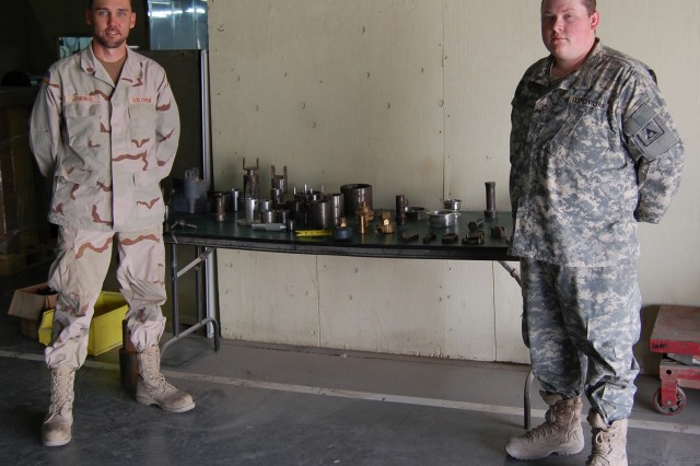 Mobile Parts Hospital site coordinator Lance Jennings (left) and machinist Kyle Owens are deployed to Southwest Asia from Anniston Army depot, Ala.