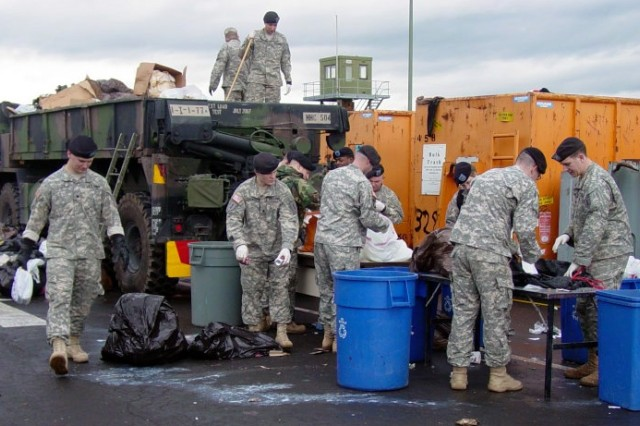 1st Infantry Division Soldiers sort waste at the U.S. Army Garrison Schweinfurt recycling sort center in January. Recycling officials say the center's program of breaking down waste has significantly reduced its costs for having refuse hauled away