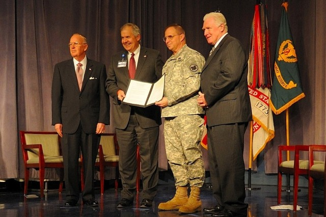 From left to right: Under Secretary of Defense for Reserve Affairs Thomas F. Hall, Inova Chief Executive Officer Knox Singleton, chief of the Army Reserve Lt. Gen. Jack C. Stultz and Congressman (Va.) Jim Moran signed a Reserve Employer partnership linking the Army Reserve and Inova Health System.