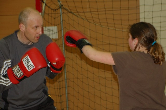 """Volunteer boxing coach Ralf Gers became a volunteer with USAG Shine's Youth Services programs when his young son asked him to coach a team. """"It's something I can do to pay back the good work that Youth Services has done for my own"""