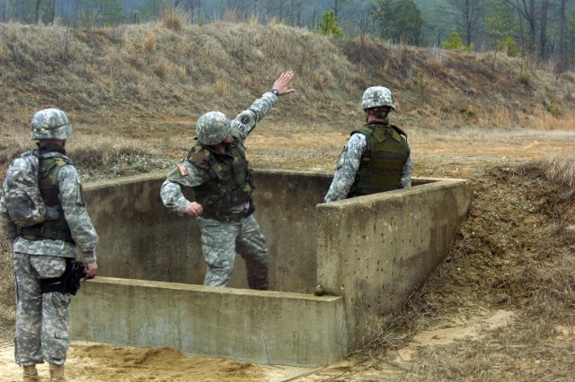 Staff Sgt. Pedro Rodriguez, the 241st's training NCO, shows his form and accuracy on the grenade range at Fort A.P. Hill.