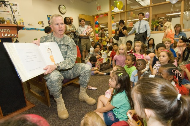 U.S. Forces Korea Commander Gen. B.B. Bell reads a story to about 100 children Aug. 1 at the Yongsan Library.