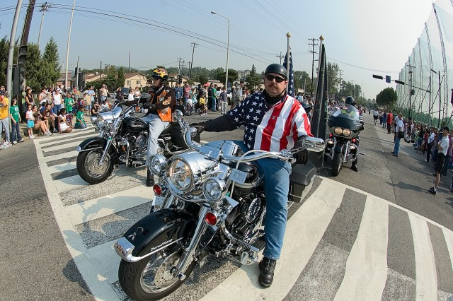 Yongsan community member Sam Berry revs up his Harley and displays his patriotism Oct. 14 during the Yongsan Fall Festival parade.