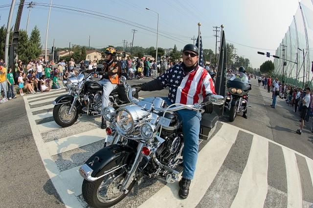 Yongsan community member Sam Berry revs up his Harley and displays his patriotism Oct. 14 during the Yongsan Fall Festival parade.