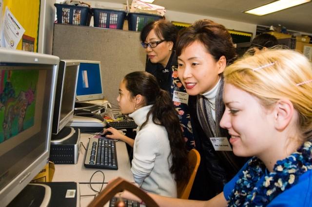 Korean teachers observe American students Dec. 5 at Seoul American Middle School. The Seoul USO sponsored the Good Neighbor Program visit to enhance cross-cultural awareness.