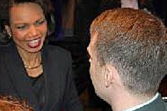Maj. Michael T. Grissom shakes hands with Secretary Condoleezza Rice while on his tour of study in Kiev.