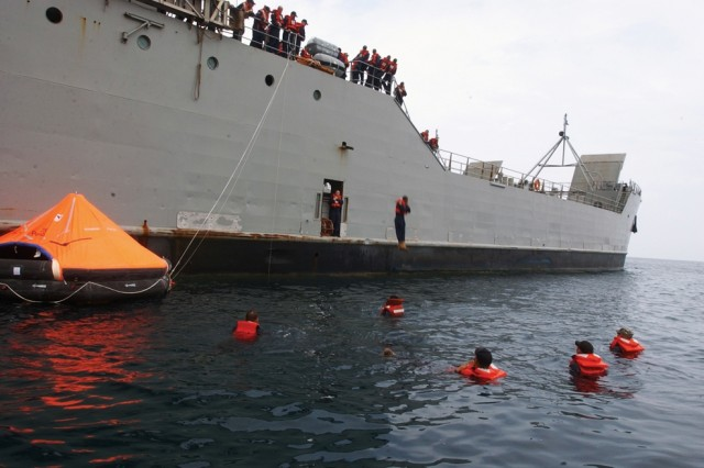 Soldiers aboard the Army Maj. Gen. Charles P. Gross Logistic Support Vessel 5 and U.S. Army Chief Warrant Officer 3 Harold C. Clinger Logistic Support Vessel 2 drop 25 feet from the ship to the water during an abandon ship drill.