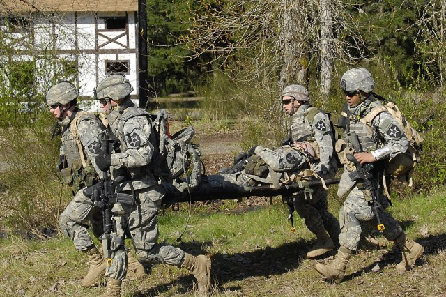 Jason KayeSoldiers from B Btry., 3-17 FA evacuate a simulated casualty during a raid on Regenburg MOUT site.