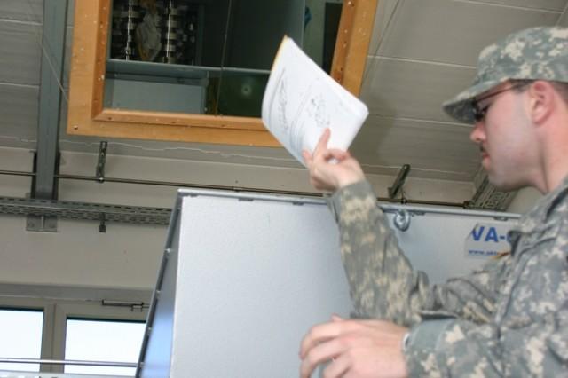 Pvt. Kurt Honicutt loads old manuals into the paper shredder at the recycling center on Conn Barracks at U.S. Army Garrison Schweinfurt.