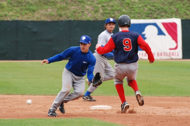 A Kaiserslautern Military Community Ambassador Baseball player reaches second base against the Italian Junior National team during play at the Italian Olympic training center near Camp Darby.