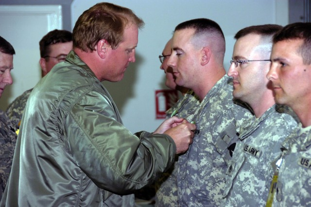 Iowa Gov. Chet Culver presents awards to Iowa National Guard troops serving with the Kansas National Guard's 35th Infantry Division at Camp Bondsteel, Kosovo, during a visit to the world's newest country on April 12, 2008. Kosovo declared independence from Serbia on Feb. 17, 2008.