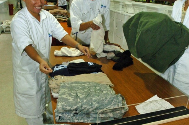Employees operate a laundry facility in the theater of operations under KBR's current LOGCAP contract.