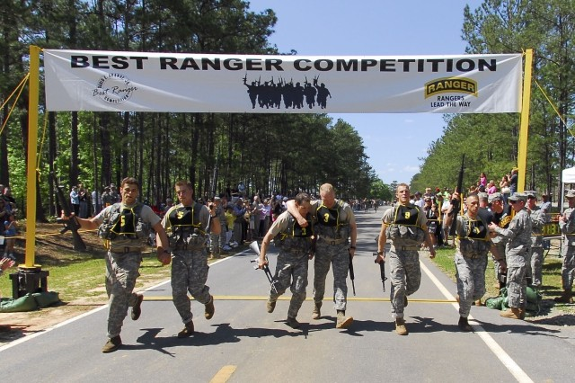 Finish Line at last for the top three teams in the 2008 David E. Grange Jr. Best Ranger Competition April 18-20 at Fort Benning, Ga. From left to right: Team five made up of Staff Sgts. Michael Broussard and Shayne Cherry representing the 75th Ranger Regiment, who took first place; brothers Capt. Jeff Soule and Maj. Greg Soule took the second spot representing James Madison University ROTC; and, team nine made up of Sgt. Jeremy Billings and Sgt. Jeremiah Beck took third representing the 75th Ranger Regt.