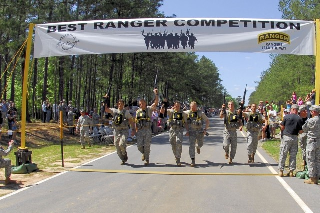 Winning teams cross the finish line Sunday at the Best Ranger Competition, Fort Benning, Ga.