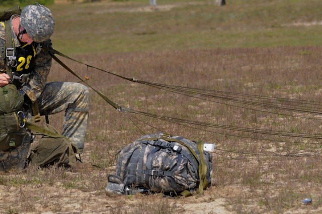 First Lt. Bryan Pittman of the 199th Infantry Brigade packs his gear before the next evolution on day one of the 2008 Best Ranger Competition April 18 at Fort Benning, Ga.