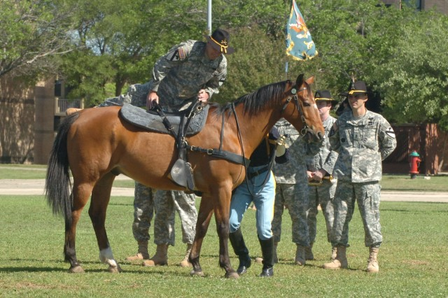 Townsend, Mont., native Command Sgt. Maj. Philip F. Johndrow mounts a horse in true cavalry spirit during a patch ceremony held at Fort Hood, Texas' Cooper Field April 18. The outgoing top noncommissioned officer said he will always be in the Cav in his mind and heart.