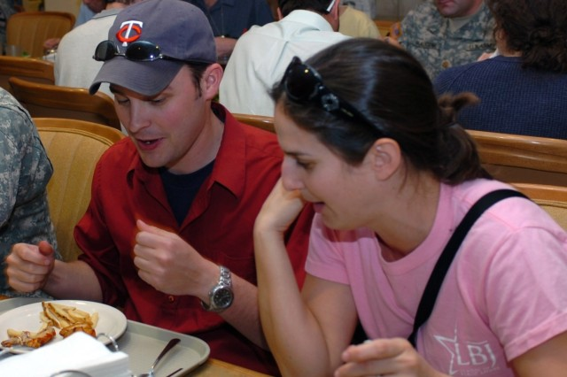 Austin, Texas, native Matt Tabbert (left) and Arlington, Texas native Stephanie Chiarello, both graduate students, excitedly discuss all they learned at the training sites they visited while eating lunch at the Ironhorse Dining Facility during their field trip to Fort Hood, Texas April 8.