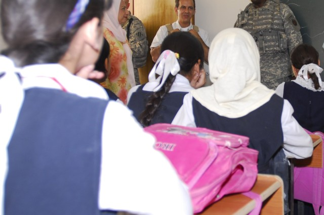 Lt. Gen. Lloyd J. Austin III, commander, Multi-National Corps-Iraq, talks with Iraqi school girls at an all girl school in Hawr rajab.  Austin spoke to them about the importance of school. He told them that if they study and work hard that one day they could be president or prime minister of Iraq. The girls all giggled.